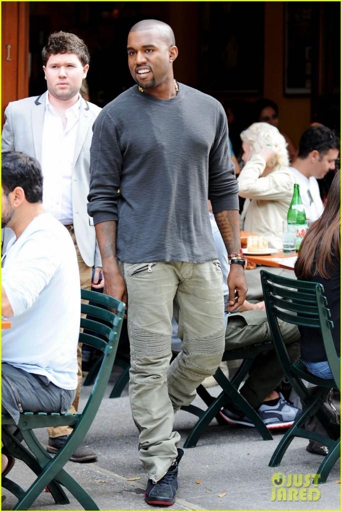 Famed hip-hop artist Kanye West leaves the popular Bar Pitti restaurant in New York City