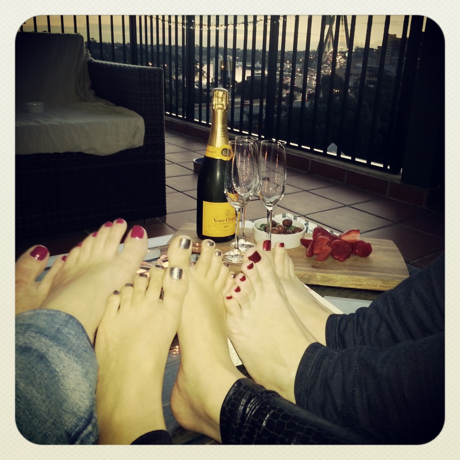 kicking off the evening on my balcony with a bottle of Veuve