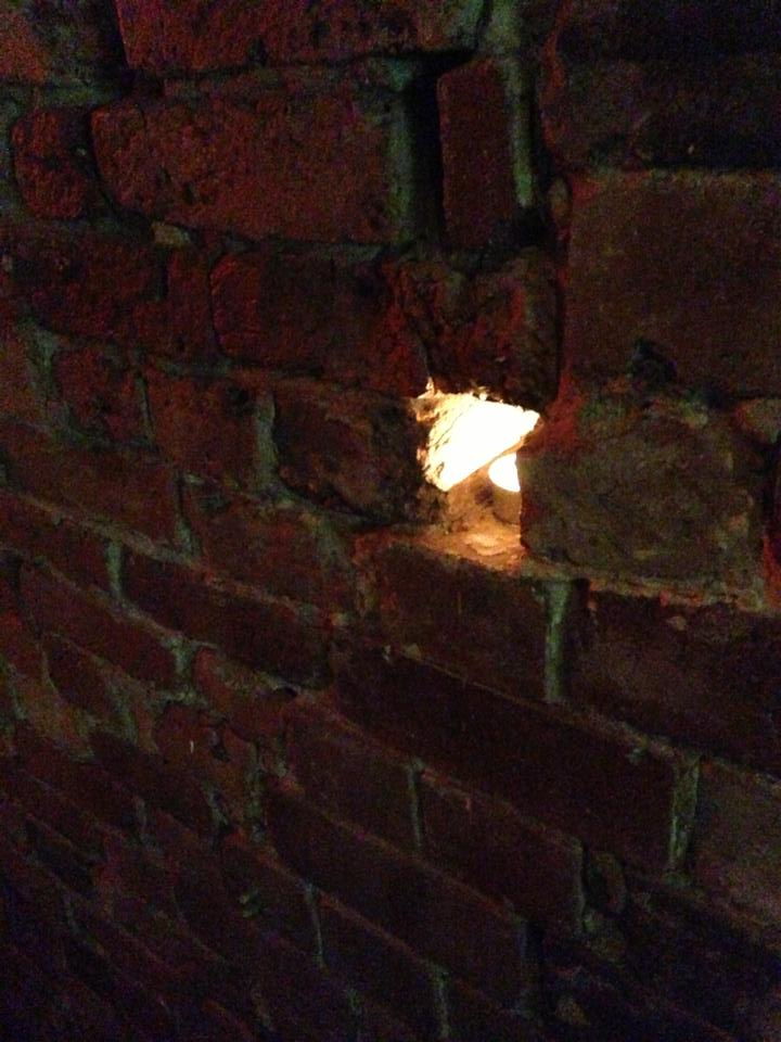 tea lights in the little wall cracks