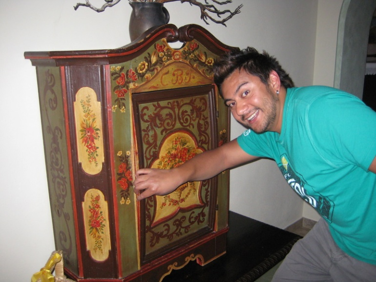 Jay, checking out an antique cupboard in the hallway of Hotel Hirsch